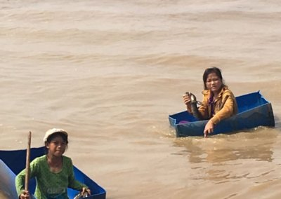 Cambodian children playing in river.